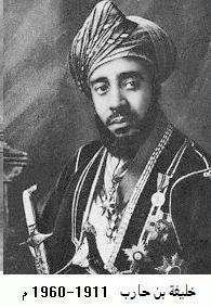 A black-and-white photograph of a man with a dark beard wearing a turban, a dark jacket, a white shirt, and several medals and looking to the right of the viewer