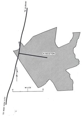 A shaded area roughly depicts the city of Kingston. A solid line passes the city to the left; one end of the line reads