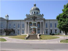Exterior view of front facade of Frontenac County Court House and fountain