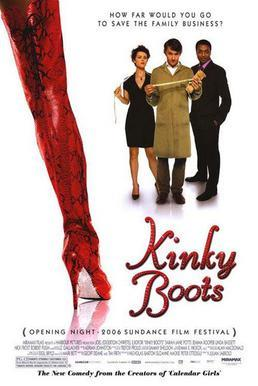 A long thigh-high red boot, fills the foreground on the left, three people stand in the distance on the back right