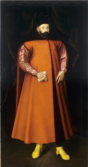 Bearded man, standing in red cloak
