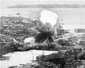 A bomb explodes in a large coastal town
