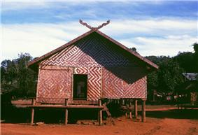 A stilted building with woven walls