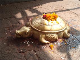 Brass sculpture of a tortoise.