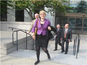 Sinema walking up stairs and smiling to the camera