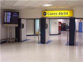 Three doorways, with gate numbers and large flight screen