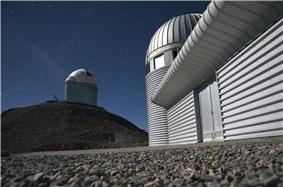 Large, round-domed telescopes seen from ground level