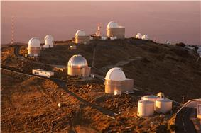 Array of telescope buildings, with access roads and towers