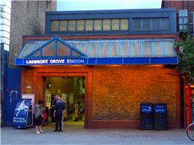 A brick building with an entrance below a sign reading