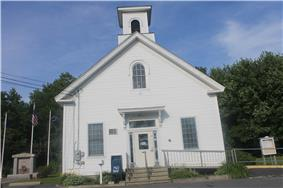 Located in a former church building is the Lamoine Town Hall, with Veterans Memorial to the left.