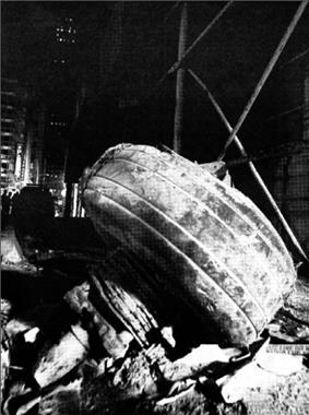 photograph of aircraft landing gear found amid debris.