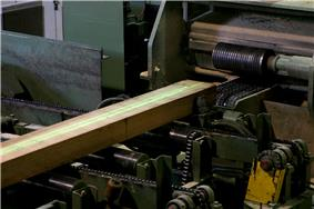 Laser guided cutting of wood in woodmill.jpg