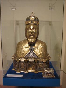 A sculpture of a bearded man wearing a crown