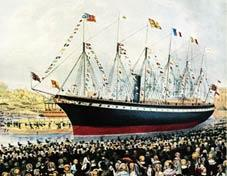 A crowd of people watch a large black and red ship with one funnel and six masts adorned with flags