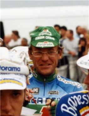 A man with glasses and a cap.