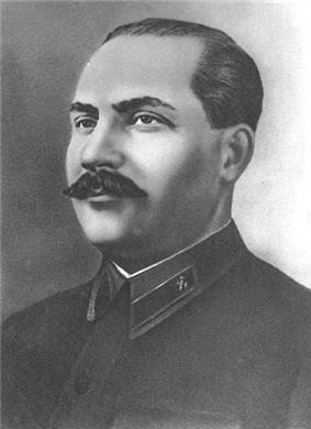 A man in a dark military clothing looking to the left