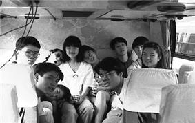 Students on the Love Boat Study Tour on a Bus.
