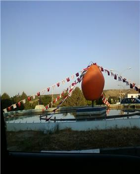 Orange monument in Lefka town center, representing its rich orange groves