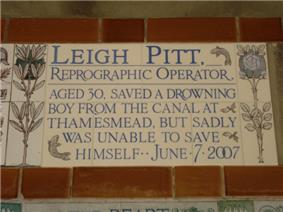 A tablet formed of five tiles of varying sizes, bordered by yellow and blue flowers in an art nouveau style and decorated with two stylised fish