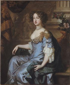 portrait of a woman with brown hair in a blue-and-gray dress