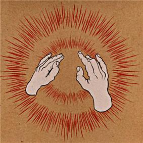 Two human hands making gestures in front of exploding red lights on a brown background.