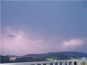Lightning flashing just over the mountains in Murree, Pakistan