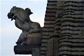 A sculpted griffin on the main temple spire