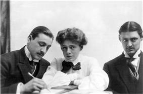 Bust-length images of the three Barrymores sitting together at a table. Barrymore has a moustache, as he does in most photos.