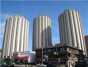 Three cylindrical residential hall buildings known as Litchfield Towers