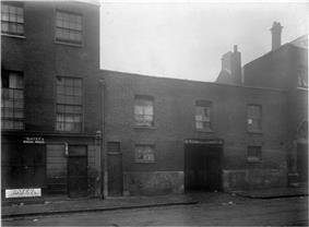 Victorian photograph of the exterior of a London slum property
