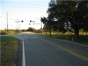 View looks southeast on FM 361 at its intersection with FM 1994.