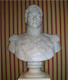Bust of a curly-haired man wearing a high collared military uniform with epaulettes.
