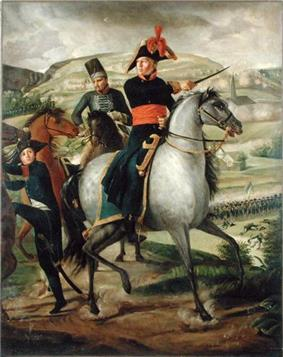 Formal full-length portrait of Turreau mounted on his white horse and leading his troops into battle. He is wearing dress military uniform, comprising white breeches with knee length black boots, dark cutaway coat with high collar and gold embroidery and a red waist sash. He points a marshal's baton..