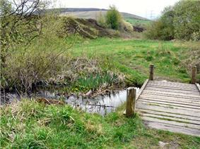 Small stream in a grassy valley