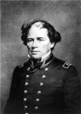Photograph of a man, seated, in double-breasted naval uniform