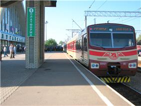 Red-and-white train at a station