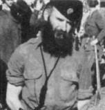 male in uniform with large beard