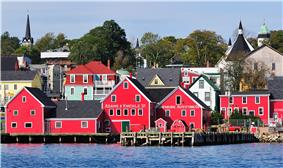 Churches and brightly colored houses near the water.