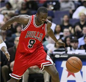 Luol Deng chasing after a loose ball
