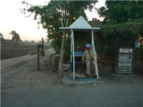 Police post with public fountain and railway used for sugar cane.