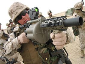 a Marine handles a grenade launcher