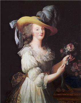 Three-quarter length portrait of a woman wearing a large straw hat with grayish-blue ostrich feathers and a ruffly cream dress with a gold bow tied at the waist in the back. She is arranging a group of pink flowers.