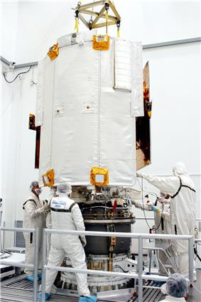 Attachment of the Payload Assist Module to MESSENGER. The ceramic-cloth sunshade is prominent in this view