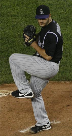 Jason Marquis throws a pitch wearing a Colorado Rockies uniform