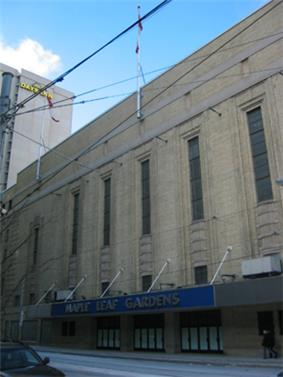 An exterior view of a building. The building has a sign that says