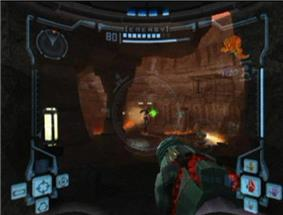View of volcanic caverns; an enemy with a jetpack shoots a green ray at the player, whose weapon (a large cannon) is visible in the corner of the screen. The image is a simulation of the heads-up display of a combat suit's helmet, with a crosshair drawn onto the enemy's location and two-dimensional icons relaying game information around the edge of the frame.