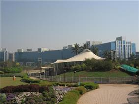 Magarpatta City SEZ Towers as seen from Aditi Gardens with Deccan Harvest in the foreground.
