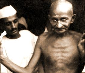 Gandhi, shirtless, with another man