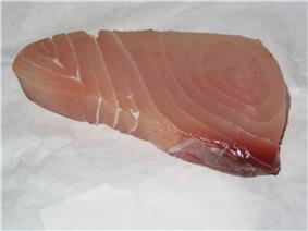 Approximately triangular piece of pink-to-red fish