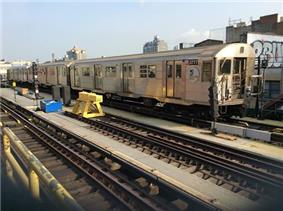 A train made of R32 cars in Z service leaving Marcy Avenue, bound for Manhattan.